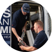 technicians using specialized tools